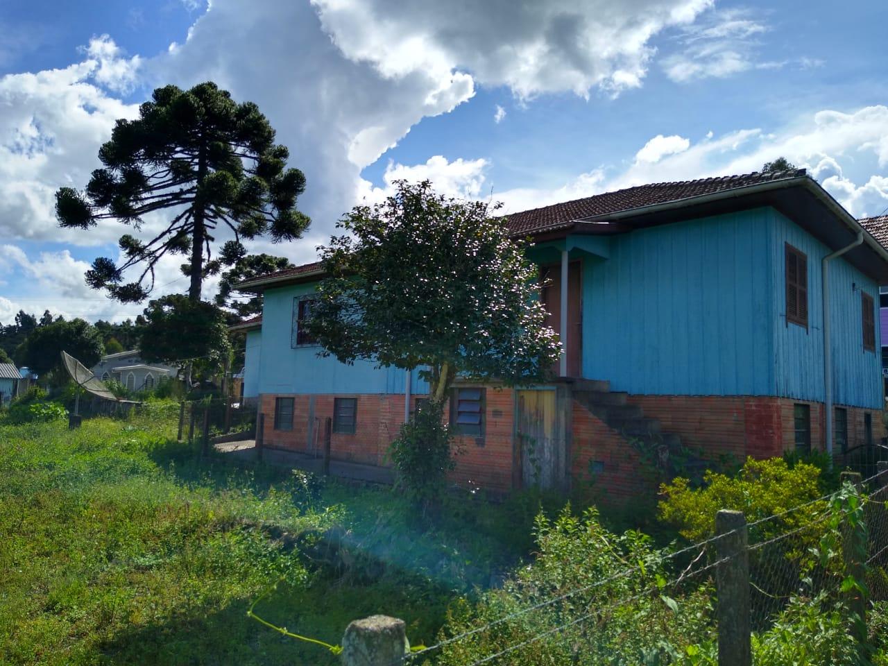 Casa com três terrenos
